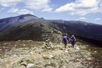 Hikers are hiking from Mt Eisenhower to Mt Washington.