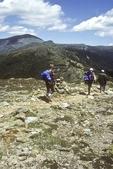 Several hikers hiking toward Mt Washington.