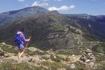 Female hiker walks along the trail from Mt Eisenhower to Mt Washington