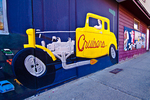 Hot rod mural painted on the outside wall of a restaurant