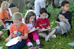 First graders working outside in nature's classroom