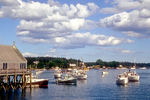 Several boats moored in Cundy's Harbor, Maine on a summer's day.