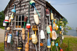 Lobster shack in Old York Village, Maine covered with lobster buoys.