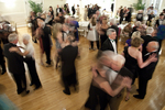 Many dancers at a formal dance
