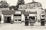 Black and white photograph of a gas station now for sale in Worcester, MA