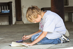 Young boy works on his watercolor painting