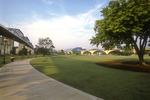 A sidewalk passes near the Walnut Street Bridge in the Tennessee River Park in Chattanooga, TN