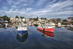 A red and blue fishing boat in Rockport Harbor