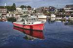A red fishing boat in Rockport Harbor