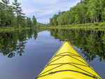 Yellow kayak heads up the Tully River in Royalston, MA
