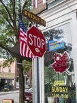 Stop sign and a flag at Bridge Street in Shelburne Falls, MA