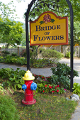 Sign for the Bridge of Flowers in Shelburne Falls, MA (and a colorful fire hydrant)
