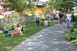 People sitting and walking along the path to the Bridge of Flowers in Shelburne Falls, MA