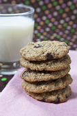 Oatmeal raisin cookies and  a glass of milk