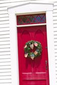 Wreath hanging on a red door