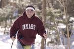 Man in UMASS sweatshirt cross country skiing