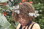 Rice Paper butterflies attracted to a woman's hair