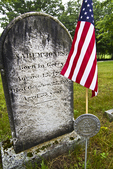 A flag flies over a soldier's grave