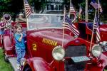 Little boy on an antique fire truck