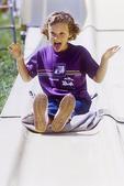 Girl sliding at an amusemant park