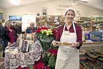 Woman offers Christmas cookies to the customers #2
