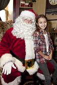 Little girl on Santa's knee.