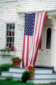 Flag flies over a Rockport, ME home's doorway