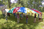 Children playing under a parachute #1