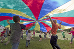 Children playing under a parachute #2