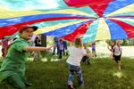 Children playing under a parachute #3