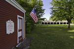 Little Red Schoolhouse with old carriage barn