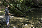 Young man fly fishing