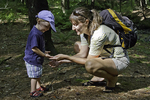 Mom shows son a red eft