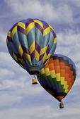 Two hot air balloons aloft