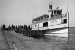 People boarding a ferry in Maine in the early 1900's - location in Maine uncertain - Moosehead Lake perhaps?