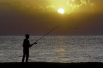 Man fishing on a Cape Cod beach
