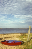 Red rowboat on a Cape Cod beach
