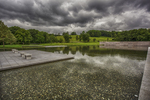 The Clark Art's reflecting pond with storm clouds overhead