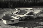 Four rowboats on the beach