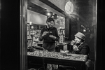 Two people having coffee in a coffee shop on Highland Street in Worcester, MA