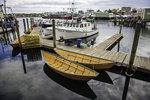 Yellow dories at the dock in Gloucester Harbor