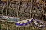 Three rowboats tied up in Rockport Harbor