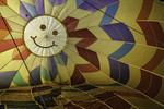 A happy face inside a balloon