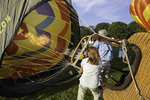 Woman inflating a hot air balloon
