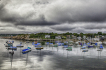 Rockport, MA harbor under stormy skies