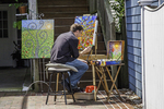 Artist painting along the street in Rockport