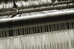 Cloth being spun on a loom