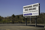Space Available sign in an empty parking lot