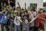 A group of kids showing their dirty hands.
