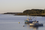 Two boats in Lubec Maine's calm and peaceful harbor